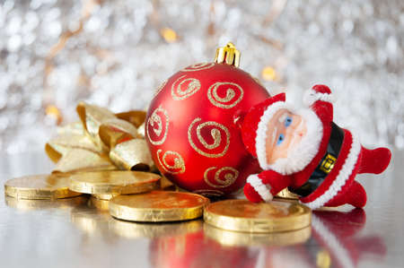 Cristmas greeting card with new year balls and coins, merry christmas and happy new year, closeup