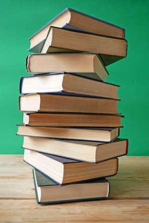 Stack of books background, many books piles