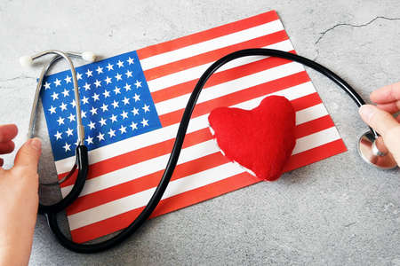 National american flag and heart. american heart month in February, closeup