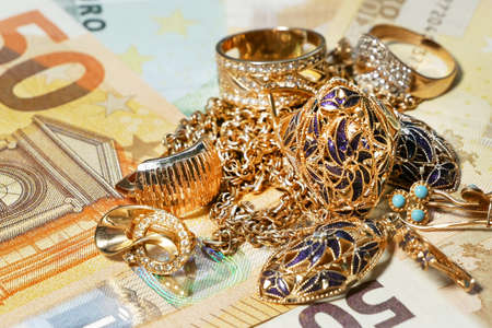 many golden and silver jewerly and money, pawnshop concept, jewerly shop, closeup