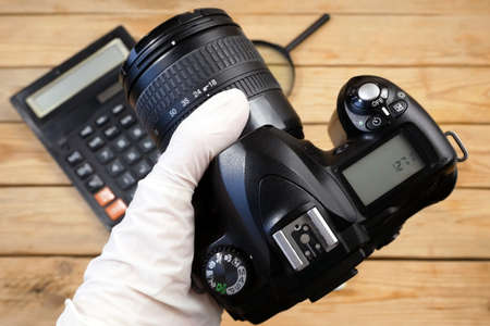 digital camera and money, store selling photographic equipment, pawnshop