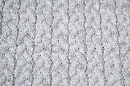 Details of knitted woolen fabric. textile background. Woolen Texture Background, Knitted Wool Fabric, Hairy Fluffy Textile. Closeup
