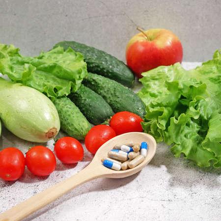 healthy food (vegetables, fruits) vs pills concept Stock Photo