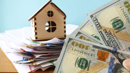 House model with real estate contract to buy house, insurance or loan and credit bank card real estate background, closeup Imagens