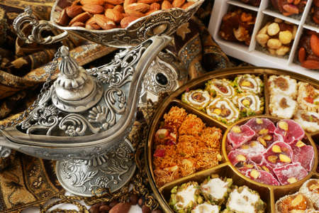 Eastern sweets with nuts, candy, dates in box background, closeup