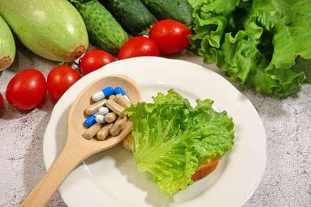 healthy food (vegetables, fruits) vs pills concept, closeup
