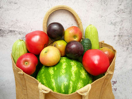 Organic Vegetables and fruits in cotton bag with copy space, green grocery delivery at home, zero waste concept