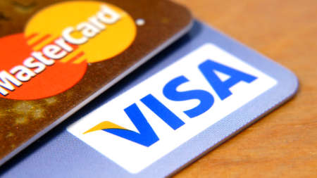 Visa credit card vs Mastercard, plastic bank card, credit or debit cards of various payment systems, closeup Editorial