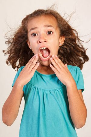 Cute Latina Girl with shocked face Stock Photo - 7333560