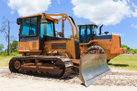 machinery: Bulldozer and Loader on job site