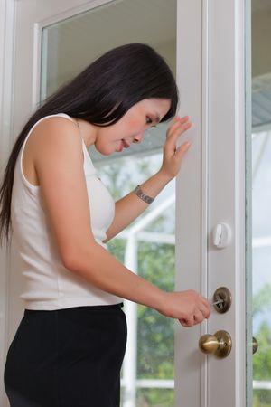 Asian Woman worker repairing door photo
