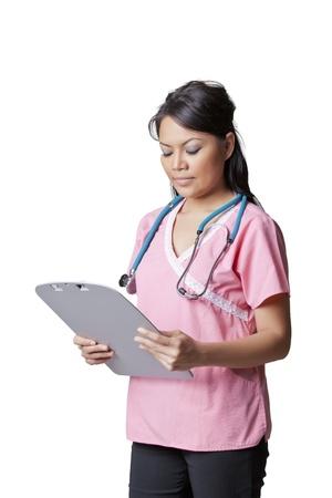 screening: Nurse holding patients chart Stock Photo