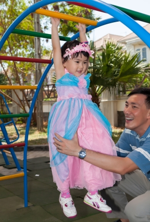 Daughter in Playground with Dad photo