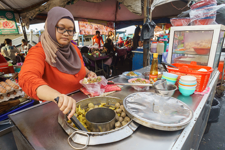 indonesian food: Kota Kinabalu Sabah Malaysia - September 20, 2015:Unidentified muslim food vendor preparing local dish called Bakso at Kota Kinabalu waterfront.The Bakso dish is originated from neighboring country Indonesia adapted by local. Editorial