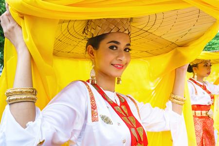 cultures: Kota Kinabalu Sabah Malaysia-August 12, 2015: Unidentified performer from Sarawak Malaysia greeting the public audience during Sabah International Folklore Festival at Kota Kinabalu.