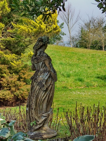 woodland sculpture: Loneliness, statue in the gardens of the Tower of Cira Stock Photo
