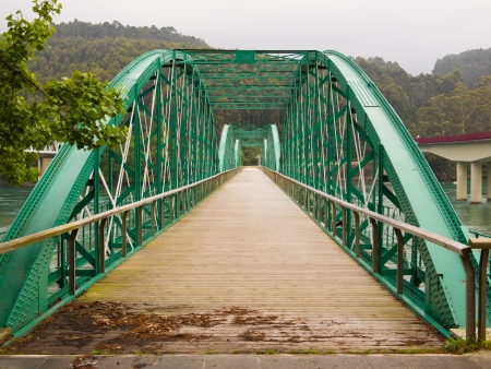 galicia: O Barqueiro metal historic bridge in Galicia northwest of Spain, Europe  The metal bridge Barqueiro O, built in the early twentieth century  1901 , is a work more interesting from the point of view of engineering from the architectural point of view  Its