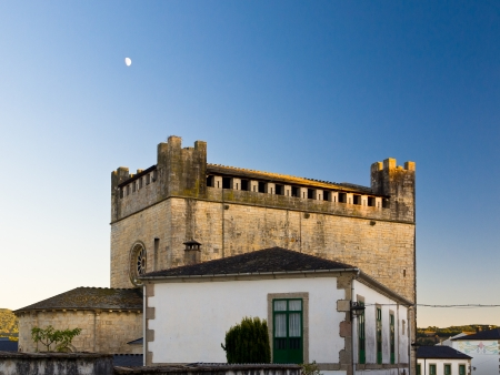 Romanesque church and castle of San Nicolas de Portomarin in Saint James way photo