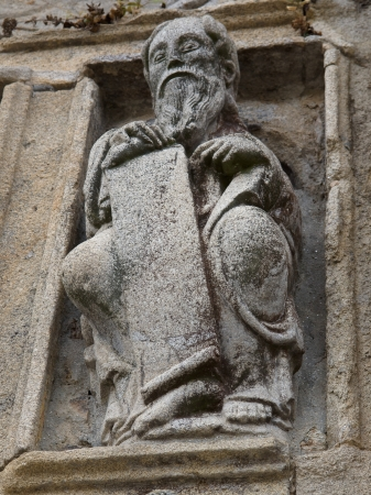 Romanesque old man in Holy Portal in Santiago de Compostela cathedral