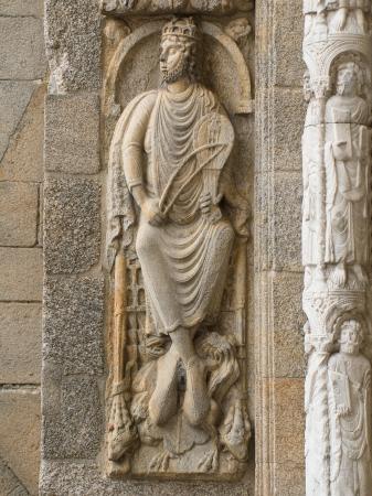 Romanesque King David in Platerias facade in Compostela cathedral Stock Photo
