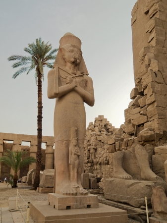 Statue of Pinedyem I in the first courtyard of the Temple of Amun at Karnak, Egypt, Africa Editorial