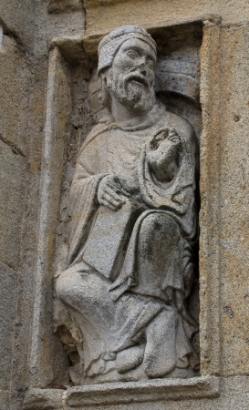 Old man in Holy Door in Saint James of Compostela Cathedral