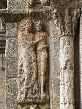 adam eve: Romanesque Adam and Eve in Platerias facade in Saint James Compostela Cathedral