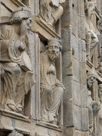 galicia: two old men talking in Holy Door in Compostela Cathedral