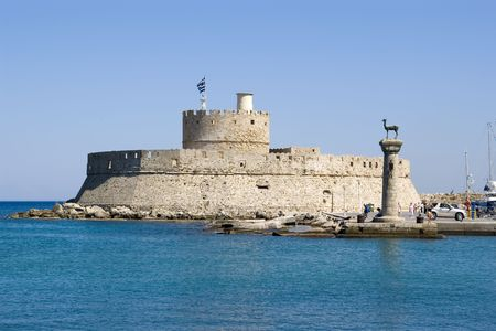 rhodes: Harbour Gates and Lighthouse St. Nicholas at Rhodes, Greece. There are also two bronze deer. Erected where probably the famous Colossus of Rhodes used to stand.