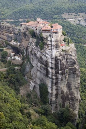 The Meteora (suspended rocks) is the largest and most important complex of monasteries in all of Greece, second only to Mount Athos. The monasteries are built on spectacular natural sandstone rock pillars, at the northwestern edge of the Plain of Thessa photo