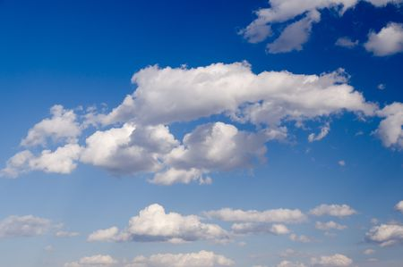 White clouds over blue sky photo