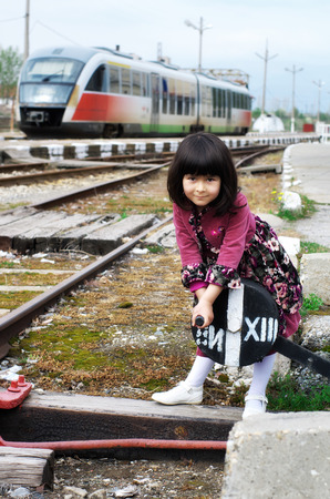 Little girl on a train station Standard-Bild