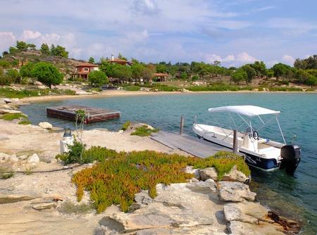 Boat at the bay, Diaporos island, Sithonia, Greece Standard-Bild