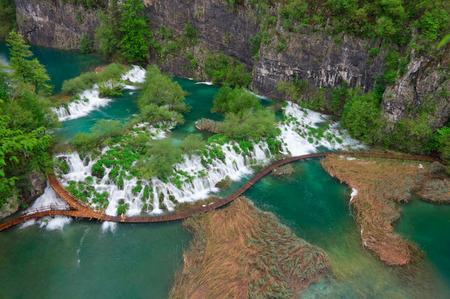 Cascades near the tourist path in Plitvice lakes national park in Croatia