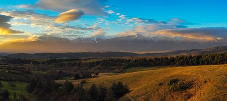 Panorama of Pirin mountain range snow peaks and blue sky with clouds, Bulgaria