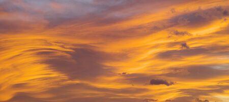 Fiery orange sunset cloudy sky. Beautiful sky.