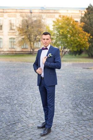 cuff link: groom in blue suit with atlas bow