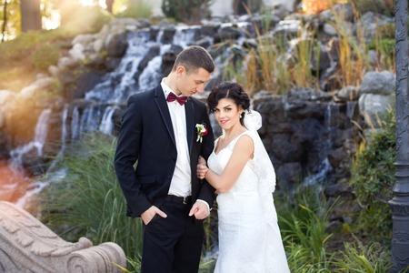 copule: wedding copule. Beautiful bride and groom. Just merried. Close up. Happy bride and groom on their wedding hugging.