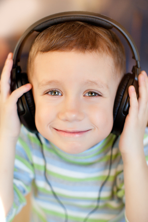 listens: The child listens to music on headphones