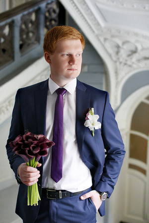 buttonhole: buttonhole on the grooms suit from a rose