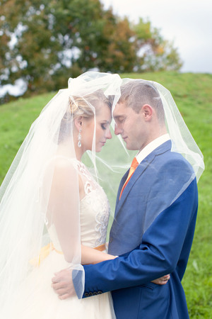 forest railroad: Newlyweds walks away outdoors. Railroad in the forest Stock Photo