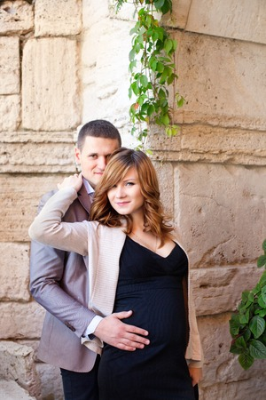 tenderly: Man tenderly embraced Pregnant Woman outdoors in the countryside