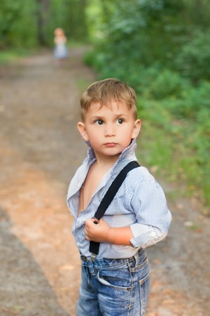 informal clothes: Boy posing at the camera in a stylish dress