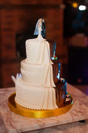 Wedding chocolate cake with figurines of the newlyweds