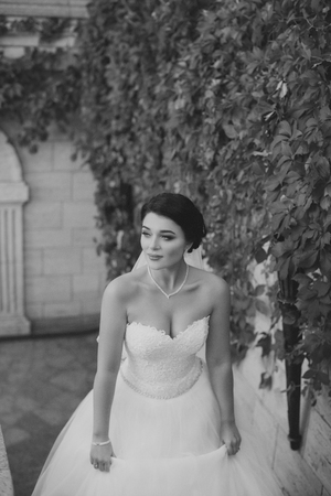 Bride in a stylish dress climbs the retro staircase
