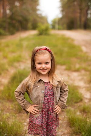 Happy girl in a summer park Standard-Bild
