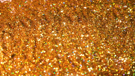 Glittering brilliance .Golden glimmered seamless loop abstract motion background