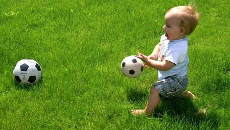 Toddler with Football Stock Photo