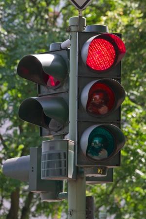 red traffic light: traffic light, road sign