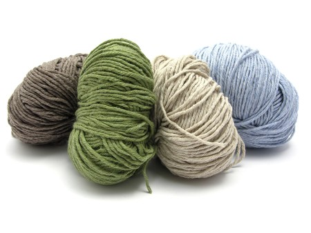 Four lying balls of wool Stock Photo